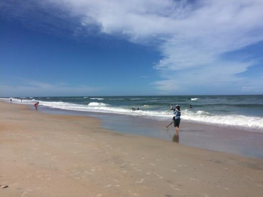 A woman scours the Vilano beach shores for metal